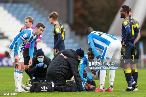 Huddersfield Town's Juninho Bacuna receives treatment at the end of the first half during the Sky Bet Championship match between Huddersfield Town...