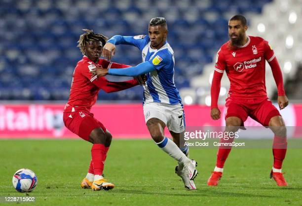 Huddersfield Town's Juninho Bacuna vies for possession with Nottingham Forest's Alex Mighten during the Sky Bet Championship match between...