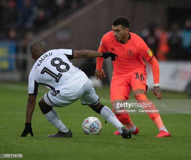 Huddersfield Town's Karlan Grant battles for possession with Swansea City's Rhian Brewster during the Sky Bet Championship match between Swansea City...