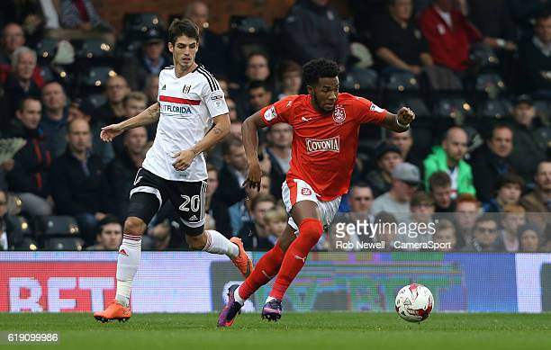 Huddersfield Town's Kasey Palmer and Fulham's Lucas Piazon during the Sky Bet Championship match between Fulham and Huddersfield Town at Craven...