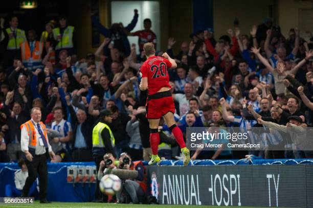 Huddersfield Town's Laurent Depoitre celebrates scoring the opening goal during the Premier League match between Chelsea and Huddersfield Town at...