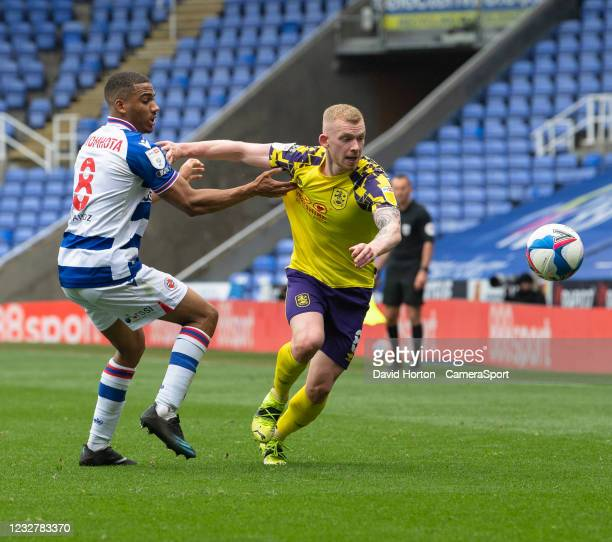 Huddersfield Town's Lewis O'Brien holds off the challenge from Reading's Andy Rinomhota during the Sky Bet Championship match between Reading and...