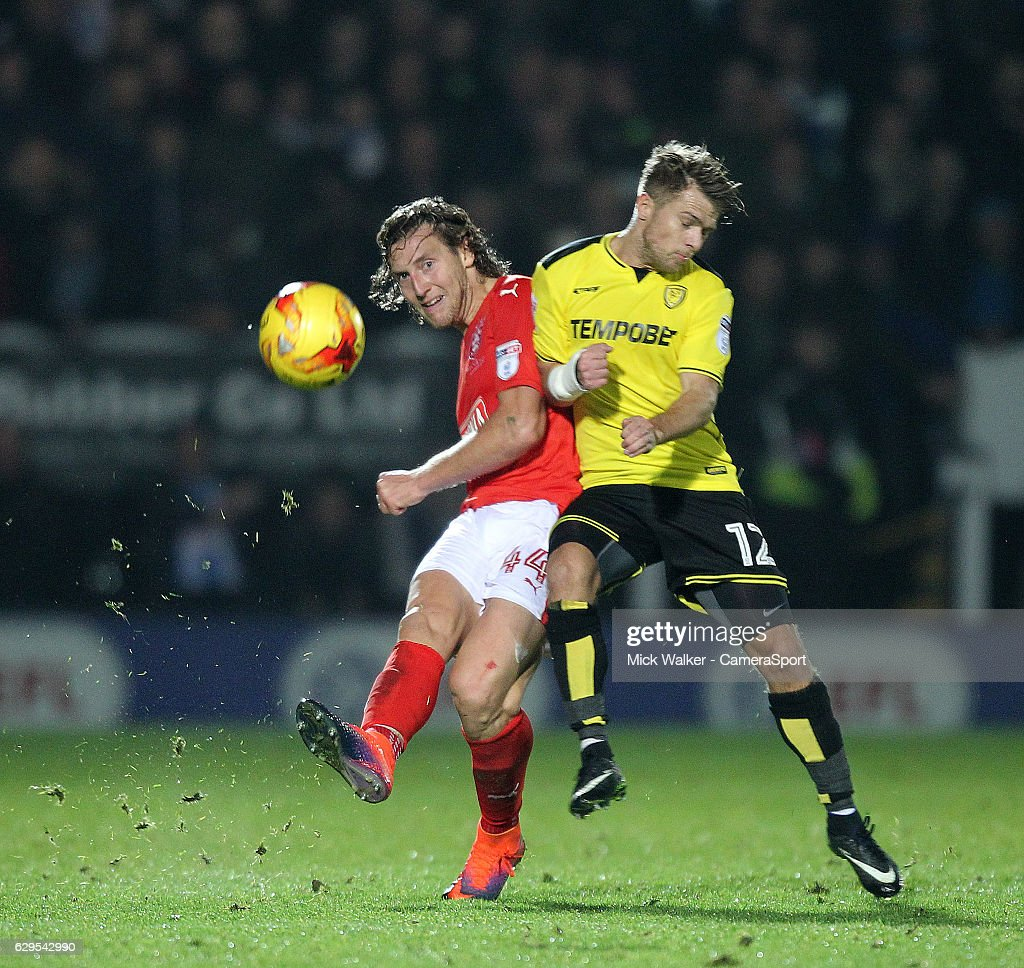 Huddersfield Town's Michael Hefele battles with Burton Albion's Jamie Ward during the Sky Bet Championship match between Burton Albion and Huddersfield Town at Pirelli Stadium on December 13, 2016 in Burton-upon-Trent, England.