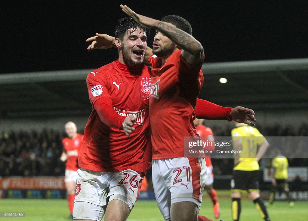 Huddersfield Town's Nahki Wells celebrates scoring his sides first goal with Christopher Schindler during the Sky Bet Championship match between Burton Albion and Huddersfield Town at Pirelli Stadium on December 13, 2016 in Burton-upon-Trent, England.