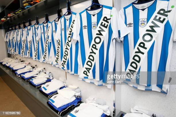 Huddersfield Town's new kit hangs in the away dressing room at theCrown Oil Arena on July 17, 2019 in Rochdale, England.