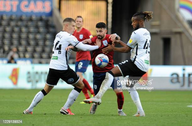 Huddersfield Town's Pipa battles with Swansea City's Jake Bidwell and Kasey Palmer during the Sky Bet Championship match between Swansea City and...