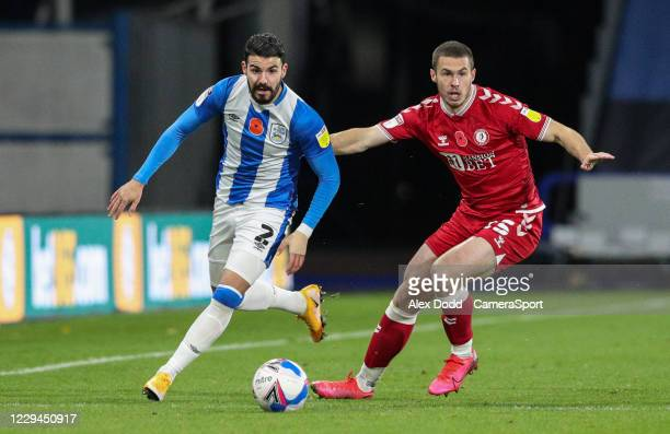 Huddersfield Town's Pipa gets away from Bristol City's Tommy Rowe during the Sky Bet Championship match between Huddersfield Town and Bristol City at...