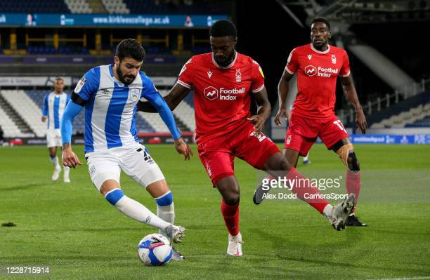 Huddersfield Town's Pipa takes on Nottingham Forest's Tyler Blackett during the Sky Bet Championship match between Huddersfield Town and Nottingham...