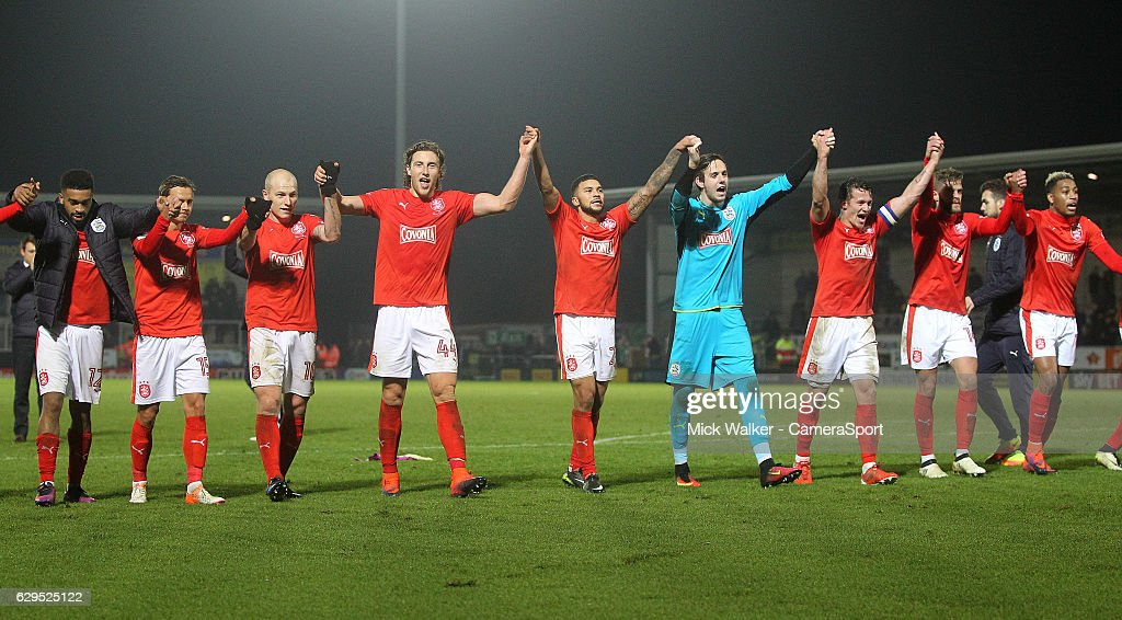 Huddersfield Town's players celebrate their win during the Sky Bet Championship match between Burton Albion and Huddersfield Town at Pirelli Stadium on December 13, 2016 in Burton-upon-Trent, England.