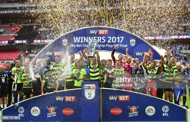 Huddersfield Town's players celebrate with the Championship Playoff trophy after winning the penalty shootout in the English Championship playoff...