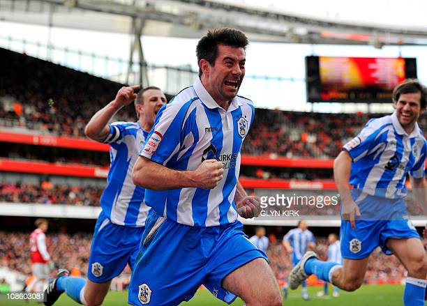 Huddersfield Town's Republic of Ireland striker Alan Lee celebrates after scoring a goal during their FA Cup 4th round football match against Arsenal...