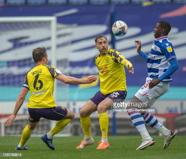 Huddersfield Town's Richard Keogh and Jonathan Hogg battles for possession with Reading's Lucas Eduardo Santos João during the Sky Bet Championship...