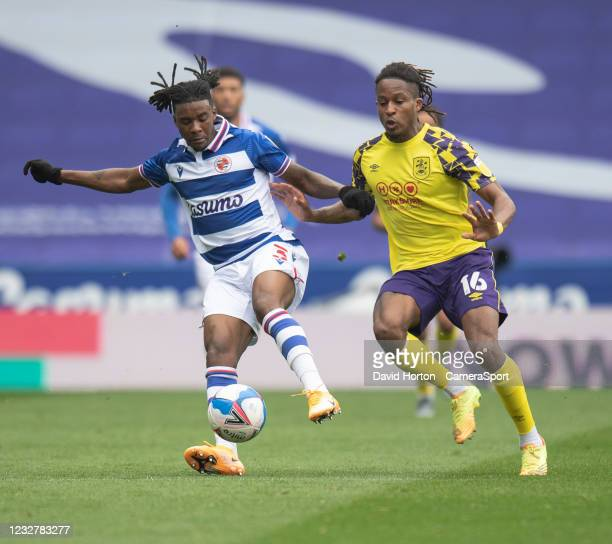 Huddersfield Town's Rolando Aarons battles for possession with Reading's Omar Richards during the Sky Bet Championship match between Reading and...