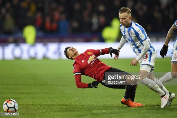 Huddersfield Town's Swiss defender Florent Hadergjonaj fouls Manchester United's Chilean striker Alexis Sanchez during the English FA Cup fifth round...