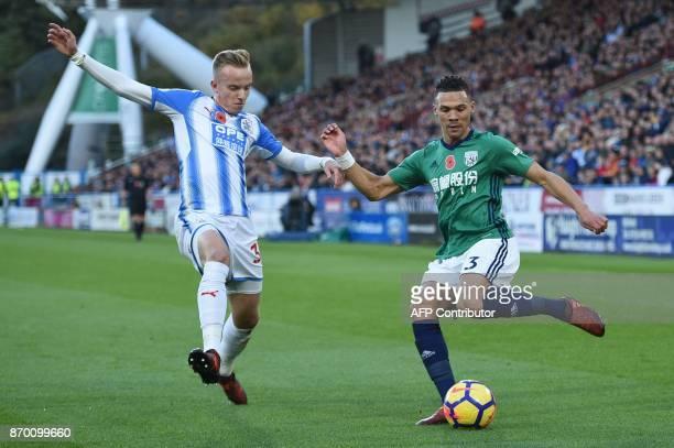 Huddersfield Town's Swiss defender Florent Hadergjonaj vies with West Bromwich Albion's English defender Kieran Gibbs during the English Premier...
