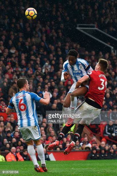 Huddersfield Town's Swissborn Dutch defender Terence Kongolo collides with Manchester United's English midfielder Scott McTominay in the penalty area...