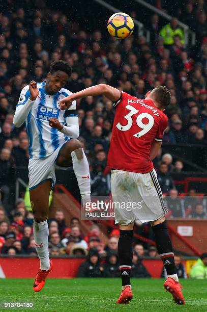 Huddersfield Town's Swissborn Dutch defender Terence Kongolo challenges Manchester United's English midfielder Scott McTominay during the English...