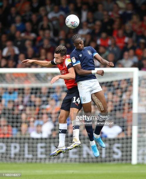 Huddersfield Town's Terence Kongolo and Luton Town's Harry Cornick during the Sky Bet Championship match between Luton Town and Huddersfield Town at...