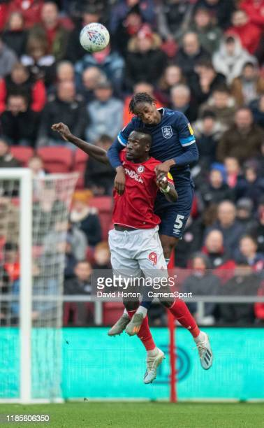 Huddersfield Town's Terence Kongolo battles with Bristol City's Famara Diedhiou during the Sky Bet Championship match between Bristol City and...