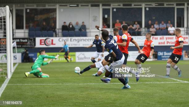 Huddersfield Town's Terence Kongolo crosses for Karlan Grant to score his side's first goal during the Sky Bet Championship match between Luton Town...