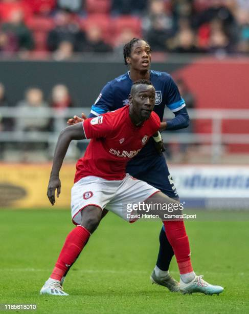 Huddersfield Town's Terence Kongolo vies for possession with Bristol City's Famara Diedhiou during the Sky Bet Championship match between Bristol...