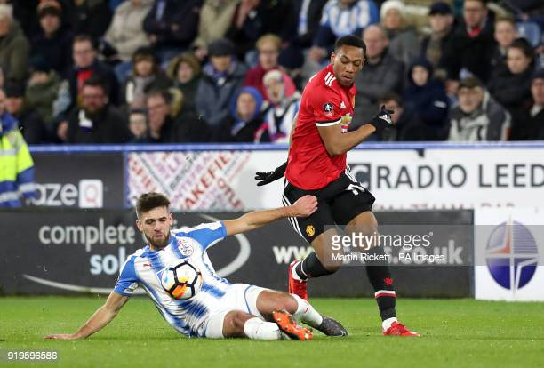 Huddersfield Town's Tommy Smith and Manchester United's Anthony Martial in action during the Emirates FA Cup Fifth Round match at The John Smith's...