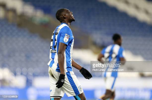 Huddersfield Town's Yaya Sanogo reacts after dragging his penalty kick wide of target during the Sky Bet Championship match between Huddersfield Town...