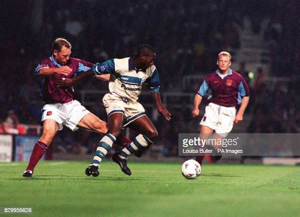 Huddersfield's Alex Dyer battles to keep possession of the ball from West Ham's Tim Breacker and Iain Dowie during their Coca Cola Cup second round...
