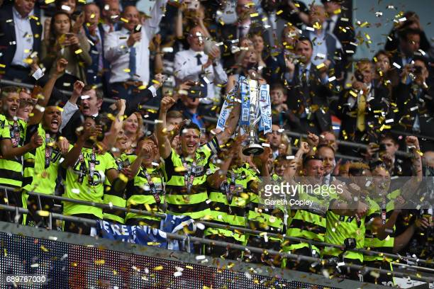 Huddersield Town players celebrates promotion to the Premier League after the Sky Bet Championship play off final between Huddersfield and Reading at...