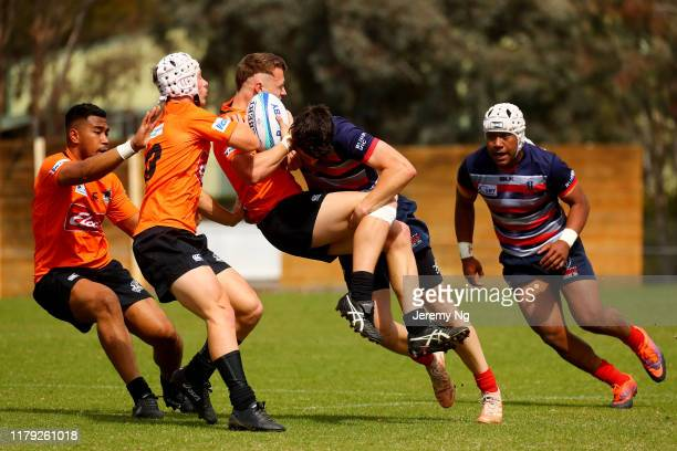 Hudson Berry of the Eagles is tackled during the round 2 National U19s Championship match between Melbourne Rebels U19s and NSW Country URC at the...