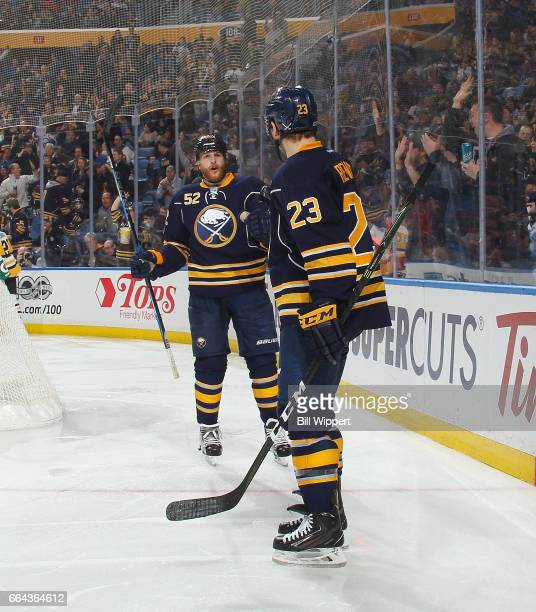 Hudson Fasching and Sam Reinhart of the Buffalo Sabres celebrate a goal against the Pittsburgh Penguins during an NHL game at the KeyBank Center on...