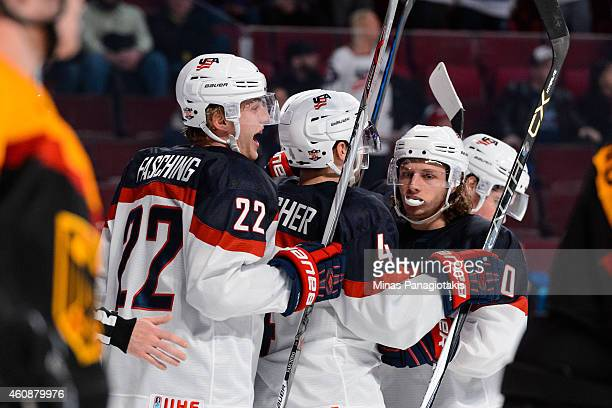 Hudson Fasching of Team United States celebrates his goal with teammates during the 2015 IIHF World Junior Hockey Championship game against Team...