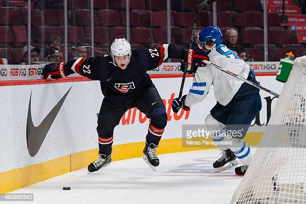 Hudson Fasching of Team United States get away from Julius Honka of Team Finland during the 2015 IIHF World Junior Hockey Championship game at the...