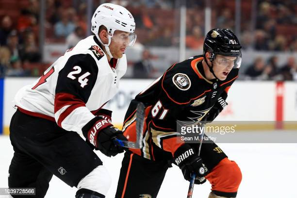 Hudson Fasching of the Arizona Coyotes defends against Troy Terry of the Anaheim Ducks during the first period of an NHL preseason game at Honda...