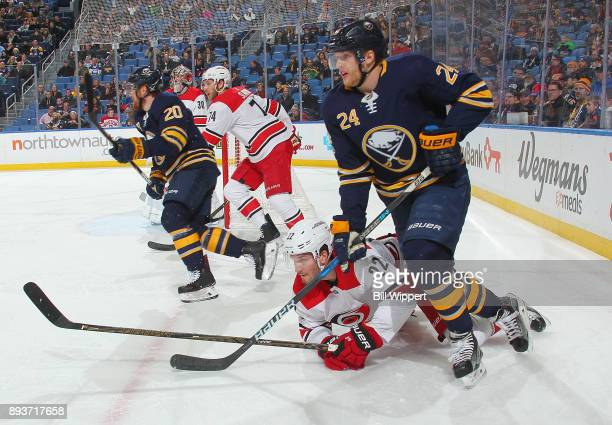 Hudson Fasching of the Buffalo Sabres and Brett Pesce of the Carolina Hurricanes follow the play during an NHL game on December 15 2017 at KeyBank...