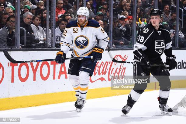 Hudson Fasching of the Buffalo Sabres and Paul LaDue of the Los Angeles Kings skate during the game on March 16 2017 at Staples Center in Los Angeles...