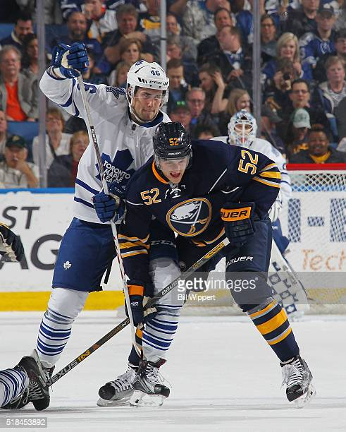 Hudson Fasching of the Buffalo Sabres battles for position with Tobias Lindberg of the Toronto Maple Leafs during an NHL game on March 31 2016 at the...
