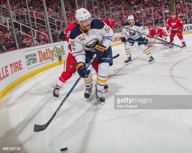 Hudson Fasching of the Buffalo Sabres controls the puck in the corner during an NHL game against the Detroit Red Wings at Joe Louis Arena on March 20...