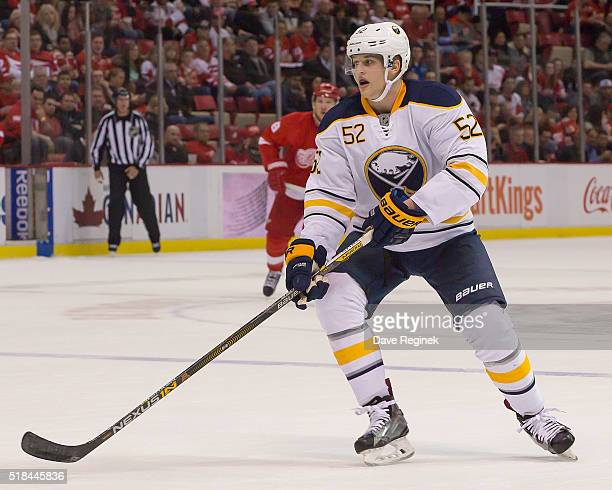 Hudson Fasching of the Buffalo Sabres follows the play against the Detroit Red Wings during an NHL game at Joe Louis Arena on March 28 2016 in...