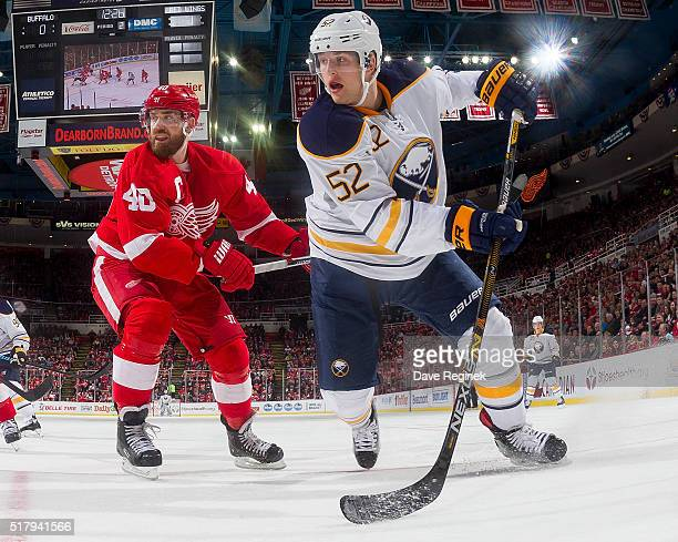 Hudson Fasching of the Buffalo Sabres follows the play in front of Henrik Zetterberg of the Detroit Red Wings during an NHL game at Joe Louis Arena...