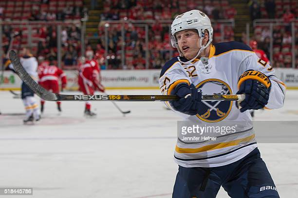 Hudson Fasching of the Buffalo Sabres shoots the puck in warm ups prior to an NHL game against the Detroit Red Wings at Joe Louis Arena on March 28...