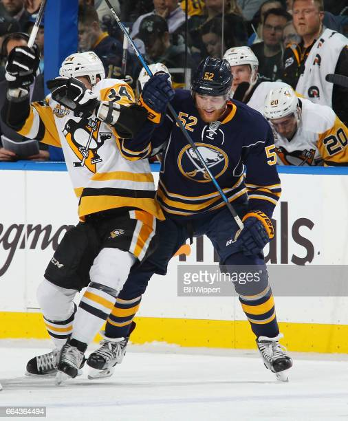 Hudson Fasching of the Buffalo Sabres skates against Tom Kuhnhackl of the Pittsburgh Penguins during an NHL game at the KeyBank Center on March 21...