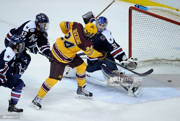 Hudson Fasching of the Minnesota Golden Gophers scores a goal against Dalton Izyk of the Robert Morris Colonials during the third period of the West...