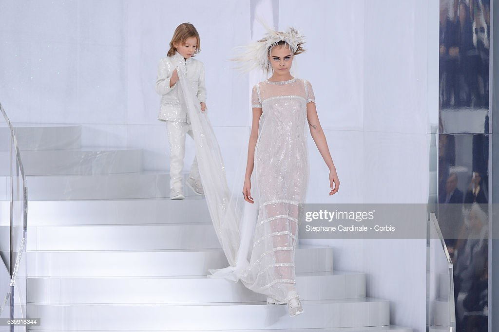 Hudson Koening and Model Cara Delevingne walk the runway at the end of the Chanel show as part of Paris Fashion Week Haute-Couture Spring/Summer 2014, at Grand Palais in Paris.