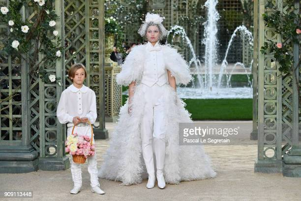 Hudson Kroenig and a model walk the runway during the Chanel Spring Summer 2018 show as part of Paris Fashion Week on January 23 2018 in Paris France