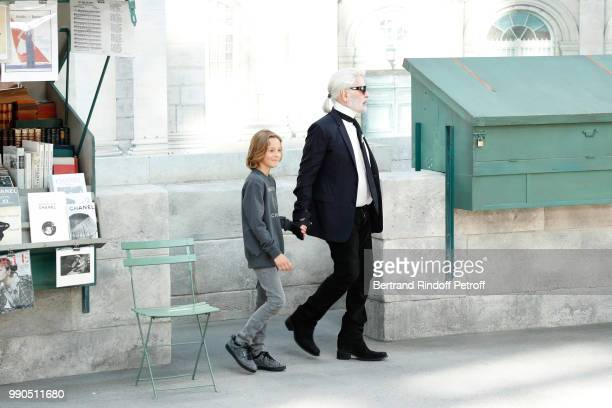 Hudson Kroenig and Chanel Stylist Karl Lagerfeld acknowledge the applause of the audience at the end of the Chanel Haute Couture Fall Winter...
