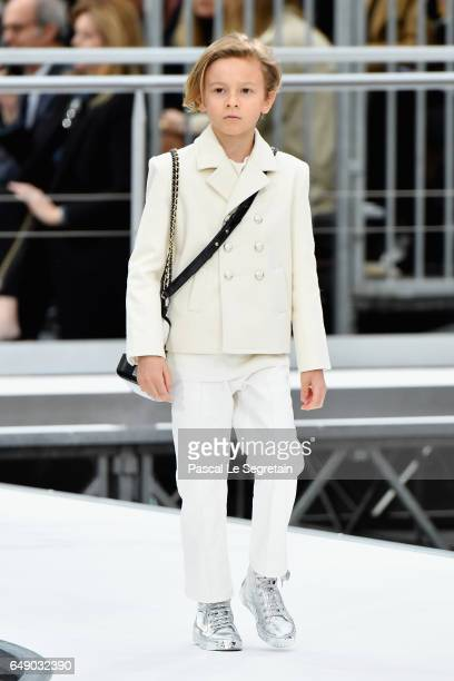 Hudson Kroenig walks the runway during the Chanel show as part of the Paris Fashion Week Womenswear Fall/Winter 2017/2018 on March 7 2017 in Paris...