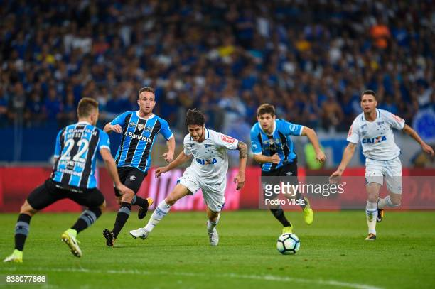 Hudson of Cruzeiro and Bressan and Arthur of Gremio battle for the ball during a match between Cruzeiro and Gremio as part of Copa do Brasil...