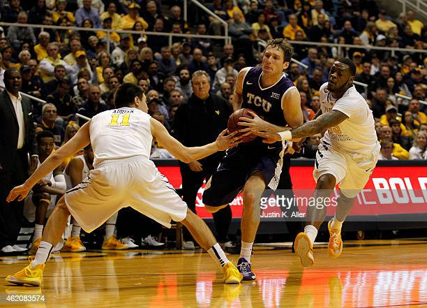 Hudson Price of the TCU Horned Frogs is fouled by Elijah Macon of the West Virginia Mountaineers during the game at the WVU Coliseum on January 24...