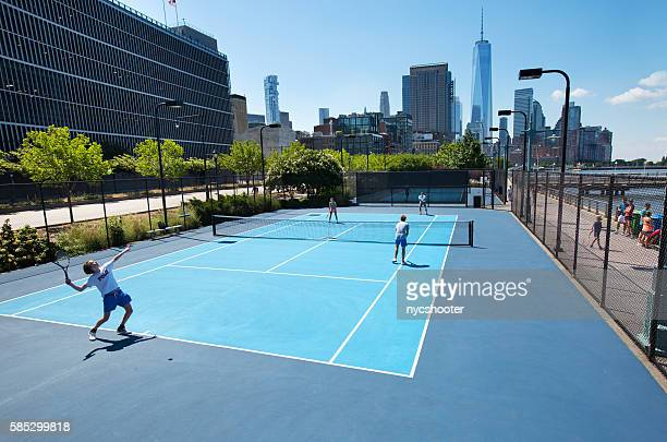 hudson river park tennis courts - doubles sports competition format stock pictures, royalty-free photos & images